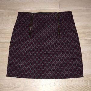 This is a red and gray skirt.